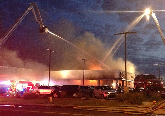 Firefighters from Scottsdale, Phoenix, Tempe and Mesa battle a fire at the Mark Kia dealership in south Scottsdale on Tuesday. (Source: Todd Jackson / CBS 5 News)