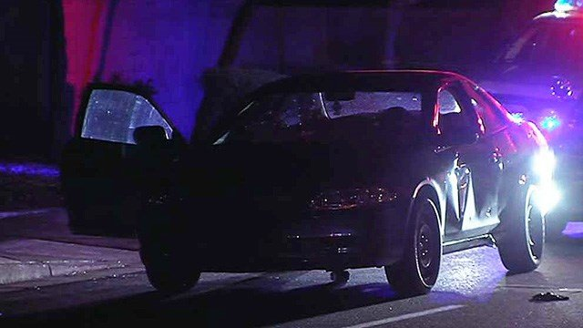 At least 15 rounds riddled this car near 16th Street and Southern Avenue during a drive-by shooting early Wednesday morning. (Source: CBS 5 News)