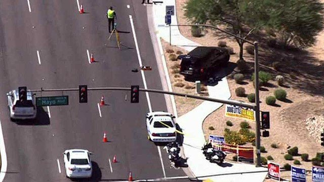 Scottsdale police investigate the scene of vehicle-pedestrian accident Tuesday morning at Scottsdale Road and Mayo Boulevard. (Source: CBS 5 News)
