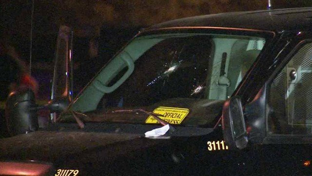 Bullet holes are visible in the windshield of this Maricopa County Sheriff's Office van after a shooting Tuesday, Oct. 28, 2014. (Source: CBS 5 News)
