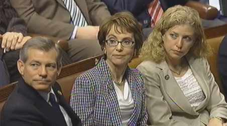 Gabby Giffords (center)