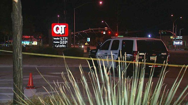 Mesa police cordoned off a QT convenience store and gas station after a clerk was shot to death early Thursday morning. (Source: CBS 5 News)