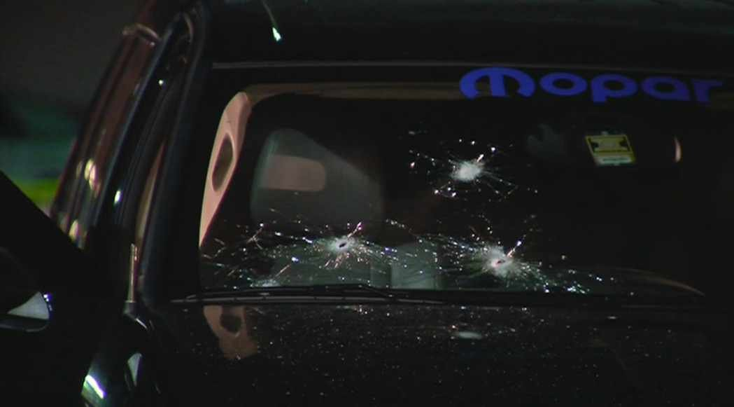 Bullets riddled the windshield of this SUV during a shootout in the parking lot of a Phoenix Walmart on Thursday night. (Source: CBS 5 News)