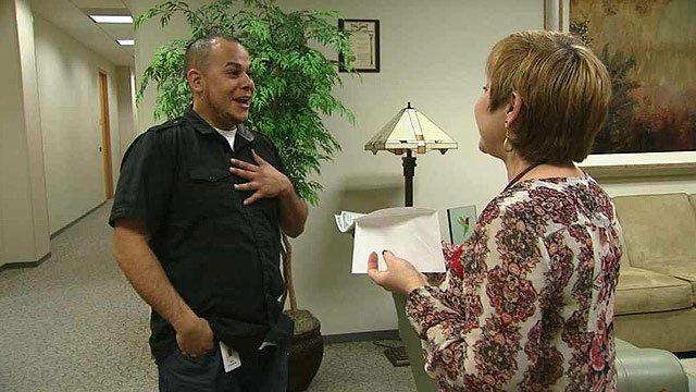 Co-worker Angie Kramer, right, surprises Mike Cisneros by paying it forward with $500 to recognize his efforts to help others. (Source: CBS 5 News)